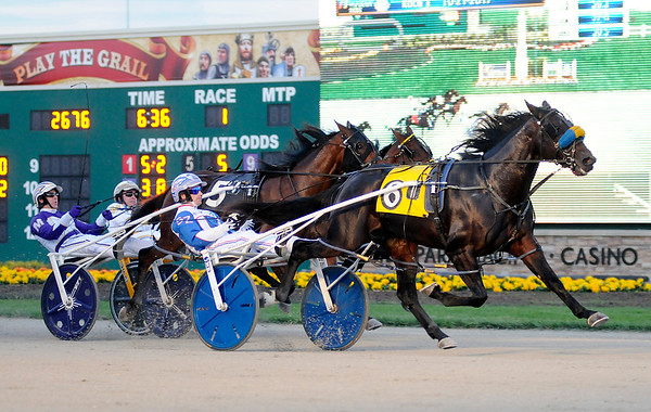 Don Knight | The Herald Bulletin<br /> Scott Zeron driving Lost In Time wins the first elimination race for 2 year old colts and geldings at Hoosier Park on Saturday. There were 14 Breeders Crown elimination races on Saturday.