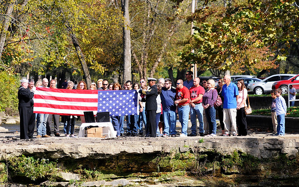 Don Knight   The Herald Bulletin<br /> Sailors fold an American Flag during a funeral service at Falls Park in Pendleton on Saturday.