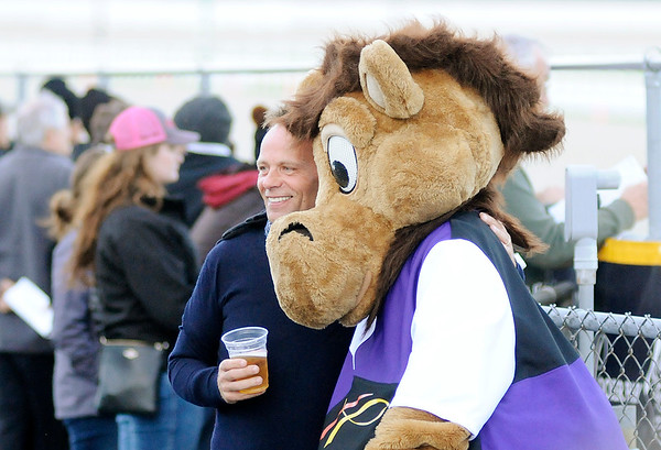 Don Knight | The Herald Bulletin<br /> Alex Falconer from Scotland poses for a photo with Hoosier Buddy during the Breeders Crown elimination races at Hoosier Park on Saturday. Falconer's brother works for Rolls-Royce in Indianapolis and whenever he comes for a visit they make a trip to Hoosier Park.
