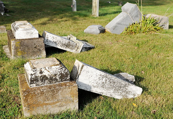 Don Knight | The Herald Bulletin<br /> The Chesterfield police department was investigating on Saturday after several grave stones at the Otterbien Cemetery were knocked over and broken.