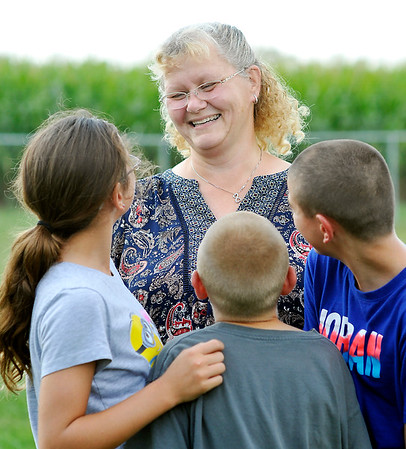 John P. Cleary |  The Herald Bulletin<br /> Breast tissue donor Donna Zemlick has a laugh with her grandchildren, Taylor Featherstone, 13, Mason Featherstone, 11, and Shane featherstone, 14.