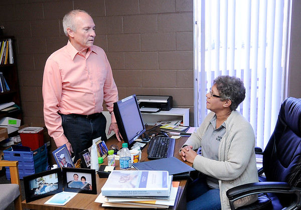 Don Knight    The Herald Bulletin<br /> Steve Ford talks to Health Educator Karen Finnigan at the Health Department on Wednesday. Ford is retiring and today is his last day with the department.