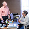 Don Knight |  The Herald Bulletin<br /> Steve Ford talks to Health Educator Karen Finnigan at the Health Department on Wednesday. Ford is retiring and today is his last day with the department.