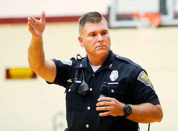 Don Knight   The Herald Bulletin<br /> State Trooper Eric Fields warns Alexandria-Monroe students about the dangers of sexting during a talk on internet safety on Thursday.