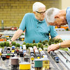 Don Knight | The Herald Bulletin<br /> Steve Mayfield puts an engine on the tracks as the model railroad club at the Anderson Public Library opened early as part of the library's open house to celebrate 30 years on Thursday. The Anderson Museum of Art also held an open house to celebrate their 50th anniversary.