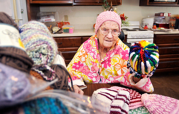 John P. Cleary |  The Herald Bulletin<br /> Betty Lawrence shows off one of about 130 hats that she has crocheted, and donated, to Community Hospital for their annual Keith Trent's Coats of Caring event.
