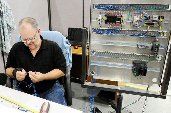 Don Knight | The Herald Bulletin<br /> Tim Hull wires a control panel at Go Electric on Thursday. The startup has won several military and industrial contracts.