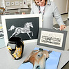 Don Knight | The Herald Bulletin<br /> Anne Pancol looks at some of the artwork submitted by Anderson students for the ART-rageous show and auction. The artwork will be on display at Hoosier Park starting today and running through the Breeders Crown.