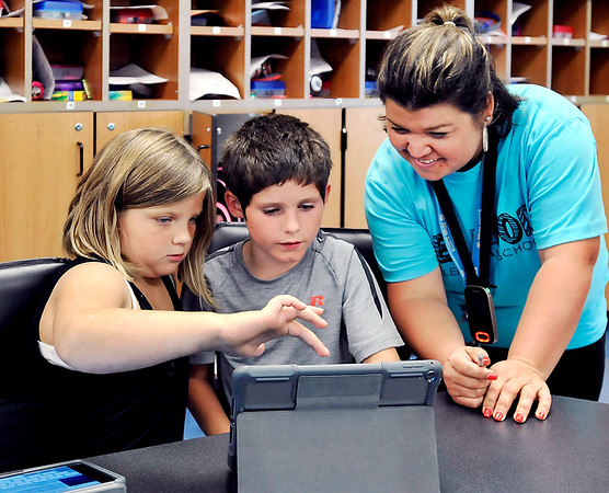 John P. Cleary |  The Herald Bulletin<br /> Students Kileigh Hughes and Cayden Timmons work together on a project as Carrie Bowman, their second grade teacher looks on at Elwood Elementary School this past week.