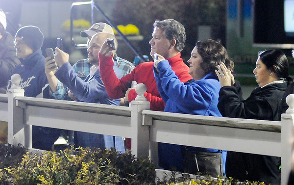 Don Knight   The Herald Bulletin<br /> Horse racing fans gather along the fence at the winners circle to get a photo of Hannelore Hanover after she won the first race of the Breeders Crown at Hoosier Park on Saturday.