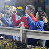 Don Knight | The Herald Bulletin<br /> Horse racing fans gather along the fence at the winners circle to get a photo of Hannelore Hanover after she won the first race of the Breeders Crown at Hoosier Park on Saturday.