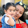 John P. Cleary |  The Herald Bulletin<br /> Consuelo Roman, 13, holds her niece, Yetzale Pachec, 1, as she waves at people attending the Hispanic Heritage Festival.