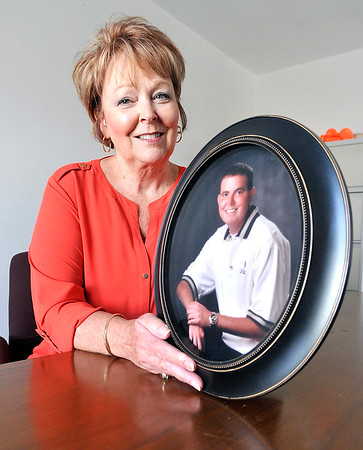 John P. Cleary |  The Herald Bulletin<br /> Pamela Shoot holds a photo of her late son Stephen Hamer, whose death from cancer inspired her to contribute to the Indiana breast tissue bank.