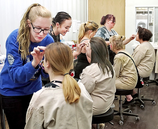 Mark Maynard | for The Herald Bulletin<br /> All stations are full as artists Alexis Stevens of Pendleton, Paityn Beard of Anderson, Kodi Swank of Crawfordsville and Kendra Smart of Anderson apply make-up to actors who will portray the insane inhabitants of Indy Scream Park's Brickmore Asylum.