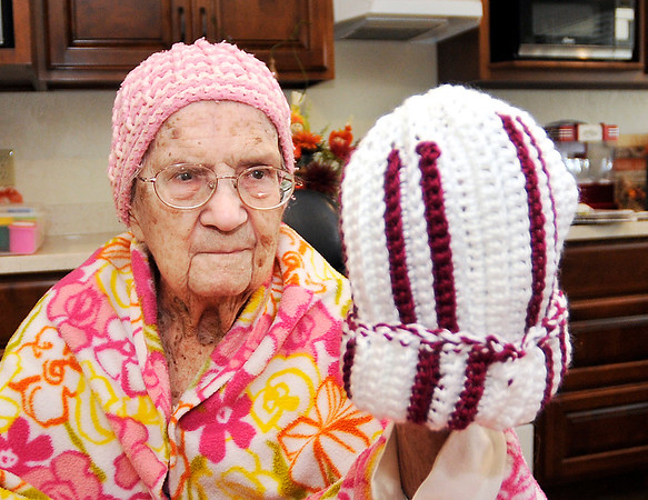John P. Cleary |  The Herald Bulletin<br /> Betty Lawrence looks over one of hats she has crocheted, and donated, to Community Hospital for their annual Keith Trent's Coats of Caring event.