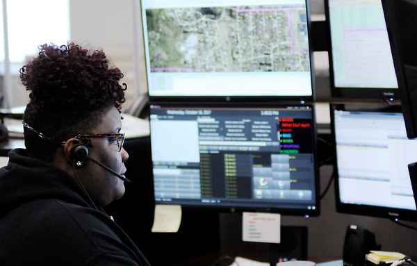 Don Knight | The Herald Bulletin<br /> Takeyla Perry works a 12 hour shift at Madison County's Central Dispatch.