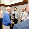 John P. Cleary |  The Herald Bulletin<br /> Carl Erskine talks to Brian Page, center, and some of his AU baseball teammates after Page was named the winner of the Carl Erskine Award of Excellence given by the Anderson Rotary Club Tuesday.