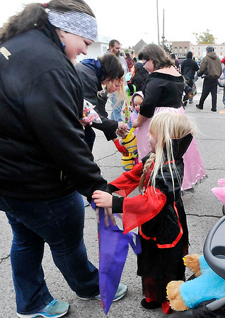 John P. Cleary |  The Herald Bulletin<br /> Elwood Halloween parade goers were treated to candy after the parade ending handed out by volunteers.