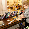 "Don Knight | The Herald Bulletin<br /> Judy Riggs, program chair for the Anderson Museum of Art's Women's League, looks at books for sale during the ""Fall into the Holiday Boutique"" sale at the museum on Friday. The event continues today from 10 a.m. to 4 p.m. with prices marked down 50 percent. Proceeds benefit the Women's League and the Anderson Museum of Art."