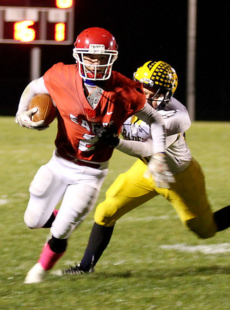 Chris Martin | For The Herald Bulletin <br /> Frankton's Dru Berkebule runs the ball Friday night in a home Sectional game against Shenandoah.