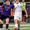 John P. Cleary | The Herald Bulletin<br /> Anderson University's Wes Erny gets the ball away to a teammate as a Defiance defender moves in.