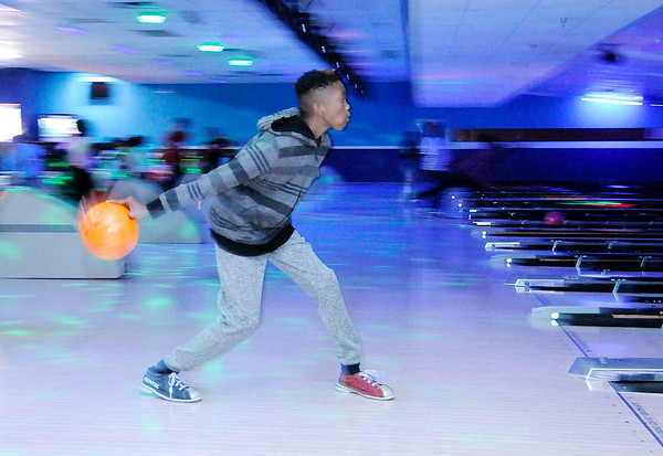 Don Knight | The Herald Bulletin A'Marien Page, 11, picks up a spare while bowling at Championship Lanes in Anderson as part of the city's Fall Break Camp.