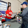 John P. Cleary | The Herald Bulletin<br /> Marine Corps veteran Brent Golish, of Anderson, talks with Emily Quillen, from Aspire, at the XnteCare Supportive Services for Veteran Families table during the Veteran's Stand Down event at national Guard Armory Friday.