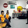 John P. Cleary | The Herald Bulletin<br /> Anderson Fire Department Deputy Chief Wilbert Kelly gives a fire prevention and safety program for children from the Midnight Tot Spot daycare Thursday.