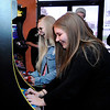 Don Knight | The Herald Bulletin<br /> From left, Alysa Madren and Kacie Peckinpaugh play video games at Digital District on Saturday.
