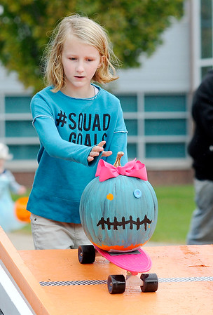 Don Knight   The Herald Bulletin<br /> Makenna Lyon races her pumpkin during Pumpkin Palooza at Anderson High School on Saturday. Lyon won the freestyle division.