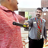 John P. Cleary | The Herald Bulletin<br /> Anderson High School assistant principal Brad Milleman uses a metal detector on students as they enter the building as part of their school safety.