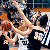 John P. Cleary | The Herald Bulletin<br /> Pendleton's Aubree Dwiggins splits Lapel defenders Kylie Rich and Makynlee Taylor as she drives to the basket.