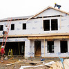 Don Knight | The Herald Bulletin<br /> A crew from JALD Construction works on one of 19 new homes under construction off 10th Street just east of Rangeline Road.