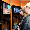 Don Knight | The Herald Bulletin<br /> Drew List looks on as Emma Waymack plays Grand Theft Auto at Digital District on Saturday.