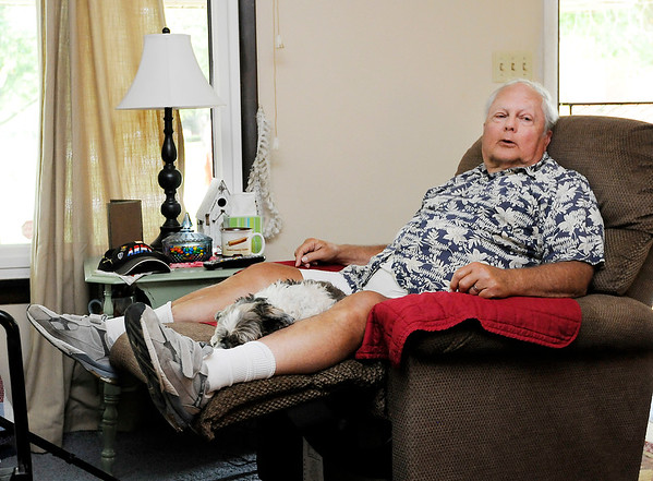 Don Knight | The Herald Bulletin<br /> Disabled veteran Dennis Robinson can only stand for short periods of time. Robinson and his wife Brenda hired Brandon Seegraves to remodel a small bathroom in their home making it handicap accessible for Dennis.