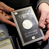 Don Knight | The Herald Bulletin<br /> Curtis Plougman holds a Carson City Silver Dollar at his coin shop, Dragon's Hoard, at 1240 Meridian Street.