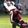 John P. Cleary | The Herald Bulletin<br /> APA's Izon McConnell puts a hit on Wes-Del's wide receiver Jake Sutton to bring him down.