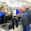 Don Knight | The Herald Bulletin<br /> Harvest Market assistant manager Char Tinch rings up a Mega Millions ticket purchase for Herb Hollenback on Thursday. Tinch has noticed increased demand for Mega Millions tickets as the jackpot is over $900 million for Friday's drawing.
