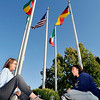John P. Cleary | The Herald Bulletin<br /> Anderson University grad student Erin Orban, and senior Ashley Lashbrook, enjoy the nice day sitting outside under the international flags flying next to York Performance Hall Monday afternoon on the AU campus.