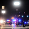 Don Knight | The Herald Bulletin<br /> EMA sets up portable lighting as APD investigates a serious accident north of the intersection of Scatterfield and Mounds Road Tuesday evening.