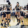 John P. Cleary | The Herald Bulletin<br /> The Lady Bulldogs celebrate after defeating Monroe Central in straight sets.