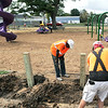 John P. Cleary | The Herald Bulletin<br /> Neighborhood kids enjoy the renovated Horne Park at 7th & John Street after the city refurbished it with new playground equipment, shelter house, and picnic tables. City Park Department workers finish up some of the landscaping details as kids play.