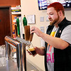 Don Knight | The Herald Bulletin<br /> Digital District co-owner Branden Holder pours a beer for a customer on Saturday. The bar held their 1980s Flashback Halloween Bash on Saturday.