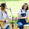 Don Knight | The Herald Bulletin<br /> Brenn Shipman and Jacob Cupps play kazoos on the last song of their set during Sneeze Fest at Shadyside Park on Saturday.
