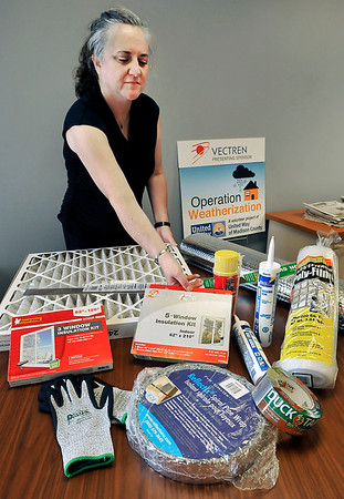 John P. Cleary | The Herald Bulletin United Way of Madison County's vice president of engagement, Kim Rogers-Hatfield, checks the different items needed for their upcoming Weatherization Day for first of November.