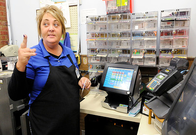 Don Knight | The Herald Bulletin Harvest Market assistant manager Char Tinch confirms a customers Mega Millions ticket request on Thursday. Tinch has noticed increased demand for Mega Millions tickets as the jackpot is over $900 million for Friday's drawing.