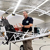John P. Cleary | The Herald Bulletin<br /> Tom Beckenbauer, program director for Cupertino Aviation Clubs Build-and-Fly center, explains the workings of the American GEM, or ground effect machine, used to help teach students the principles of flying.