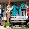 Don Knight | The Herald Bulletin<br /> Mayor Thomas Broderick Jr. looks on as Ian Flanders and Patty Kuhn unveil the plastic bench Flanders donated to the Fire Rescue House as part of his Eagle Scout Project. Ian rallied the members of Boy Scout Troop 227 to collect money and plastic bottle lids to create the bench.