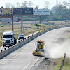 Don Knight | The Herald Bulletin<br /> A construction worker operates a sweeper in the northbound lanes of I-69 on Wednesday.