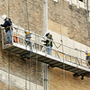 John P. Cleary | The Herald Bulletin<br /> Crews work high in the air Monday as they do brick work on the south face of the Tower Apartment building which is being refurbished.